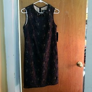 Black lace shift dress with jeweled collar